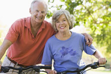 A retired couple enjoys a bike ride
