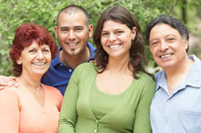 Portrait of four smiling adult family members