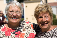 Two smiling older women outdoors