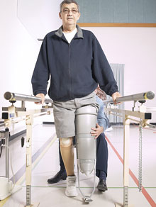A man with a prosthetic leg working with a physical therapist